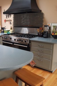 Repainted, reorganized cabinets with solid surface counters